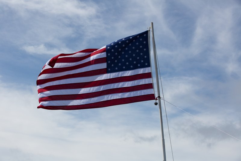 Flying Old Glory atop Mt. Garfield.