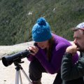 Scoping out the surrounding peaks. With the help of the Celestron we could see 13 flags.
